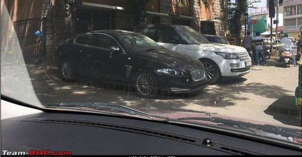 mansoor khan range rover and jaguar xf parked