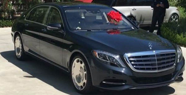 a black mercedes benz s600 wrapped up as a gift