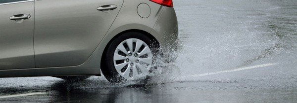 hydroplaning car on road
