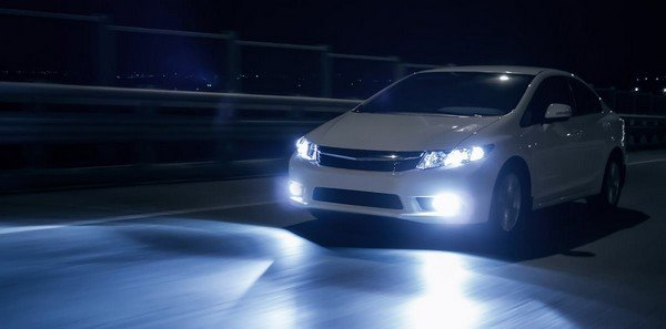 white car with high beam light on