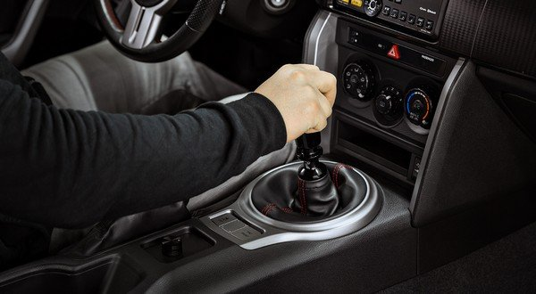 putting hand in the gear knob