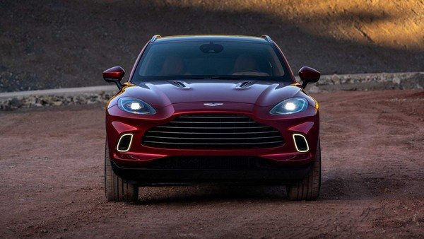 aston martin dbx red colour front angle