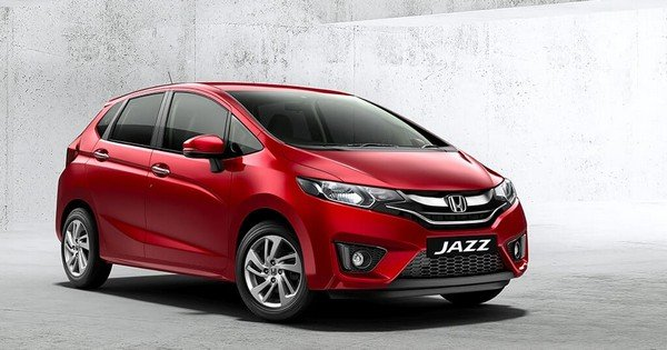 honda jazz red front three quarters right side