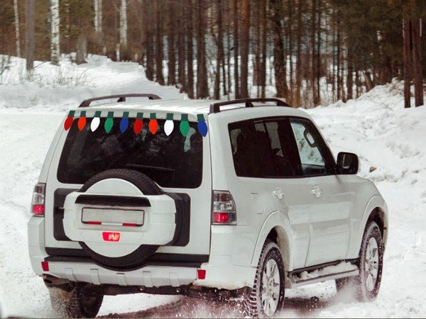 SUV parking on snow with colorful paper light