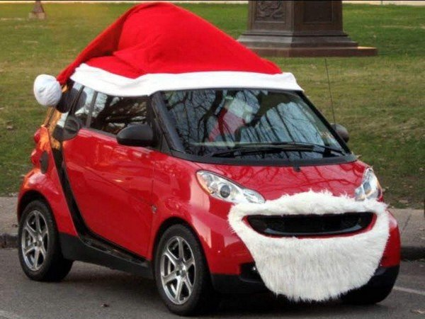 Red Hatchback car with red christmas cap