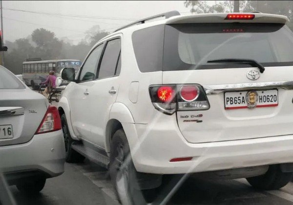 toyota fortuner police officials fined