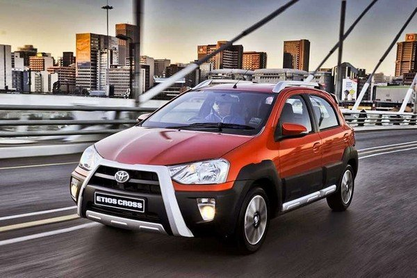 toyota etios cross orange front three quarters left side