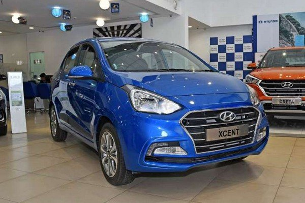 lucky car colour as per date of birth hyundai xcent blue front angle
