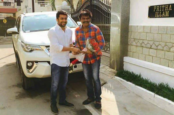 surya gives toyota fortuner to hari