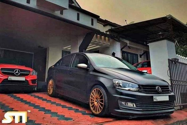 modified cars in Kerala - volkswagen vento with golden wheels