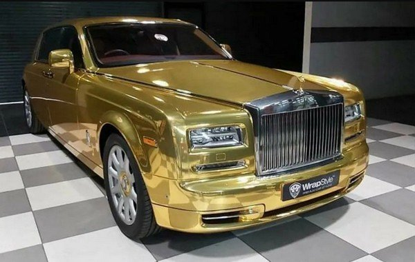 Gold-covered Rolls Royce Phantom taxi
