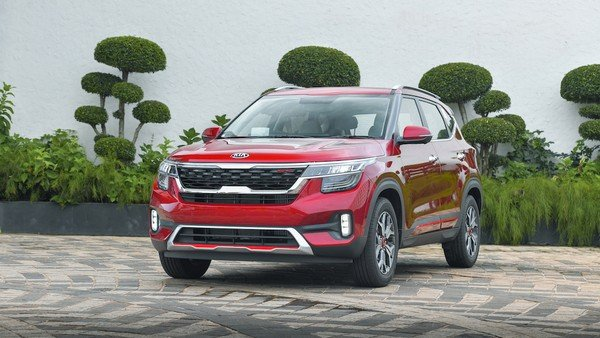 kia seltos red colour threequarter