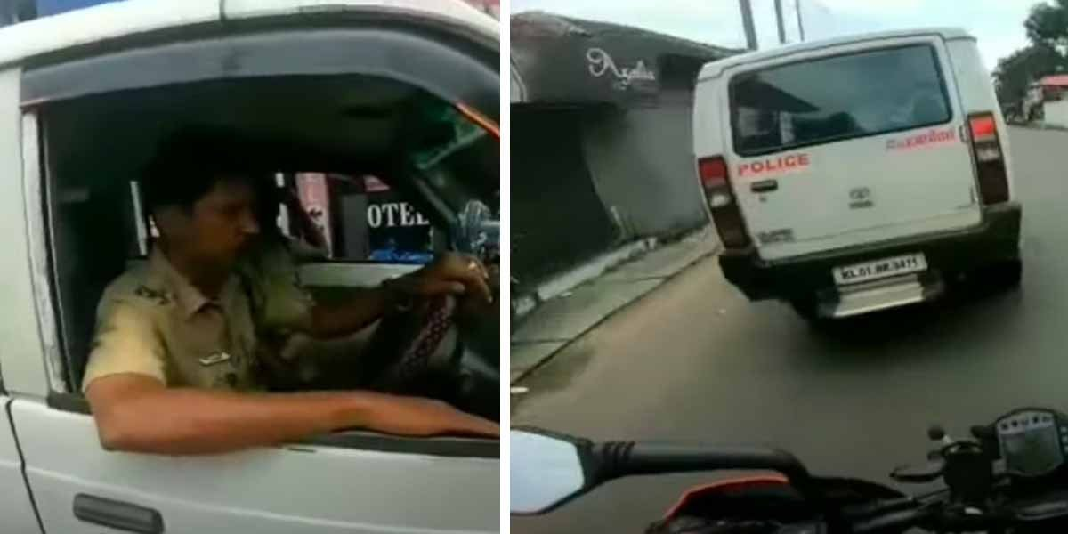Police Gets Exposed By Biker For Not Wearing Seatbelt While Driving