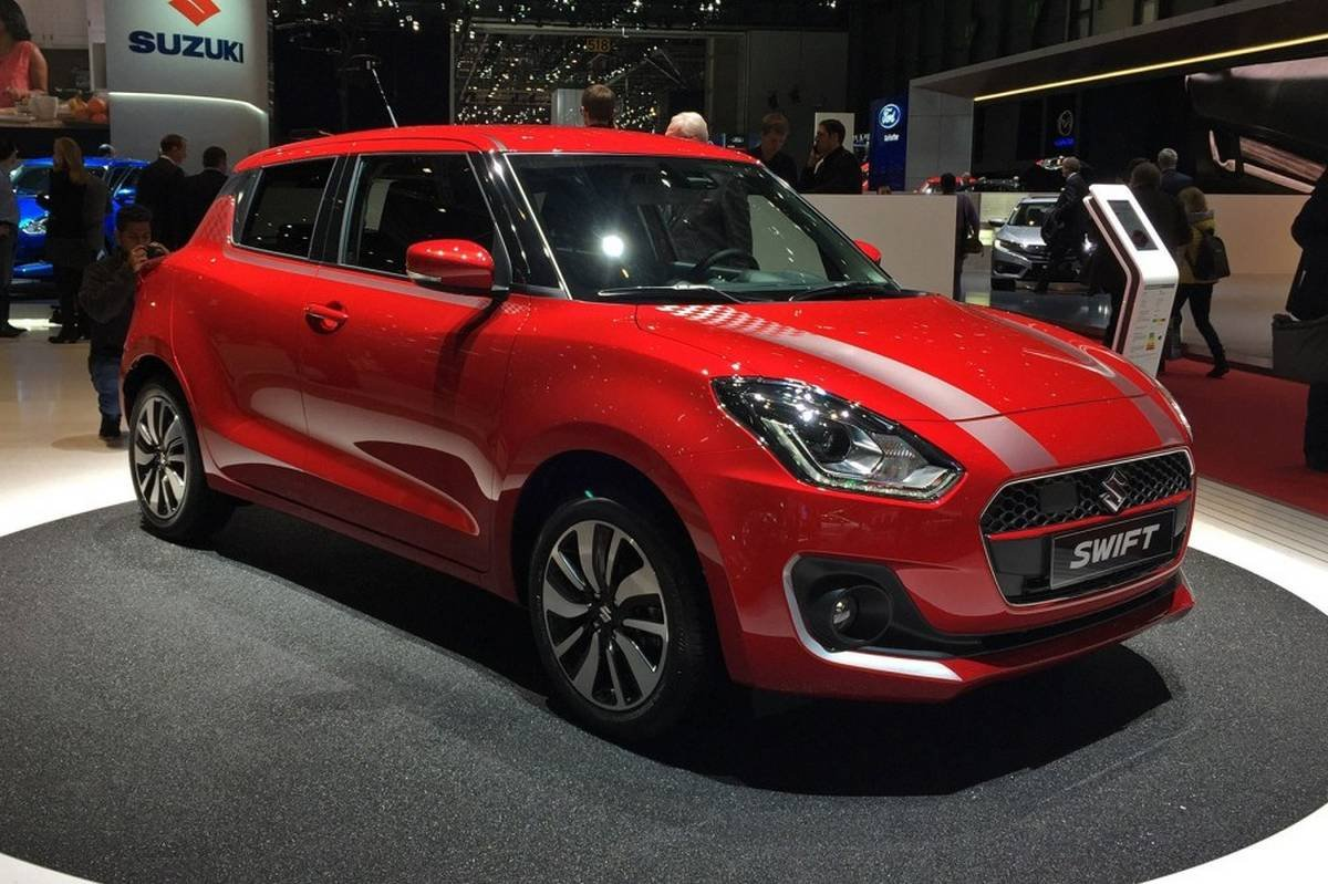 bs6 maruti swift red front three quarters