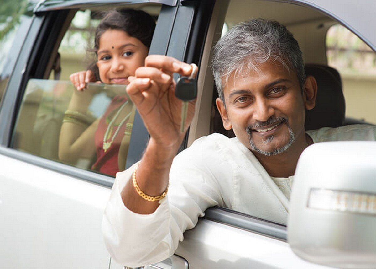 two people sitting in a car