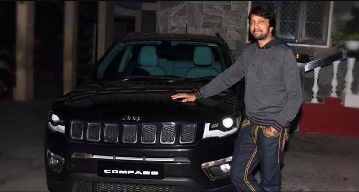 sudeep standing next to jeep-compass
