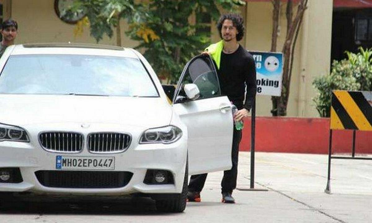 tiger shroff with bmw 5 series white colour front view