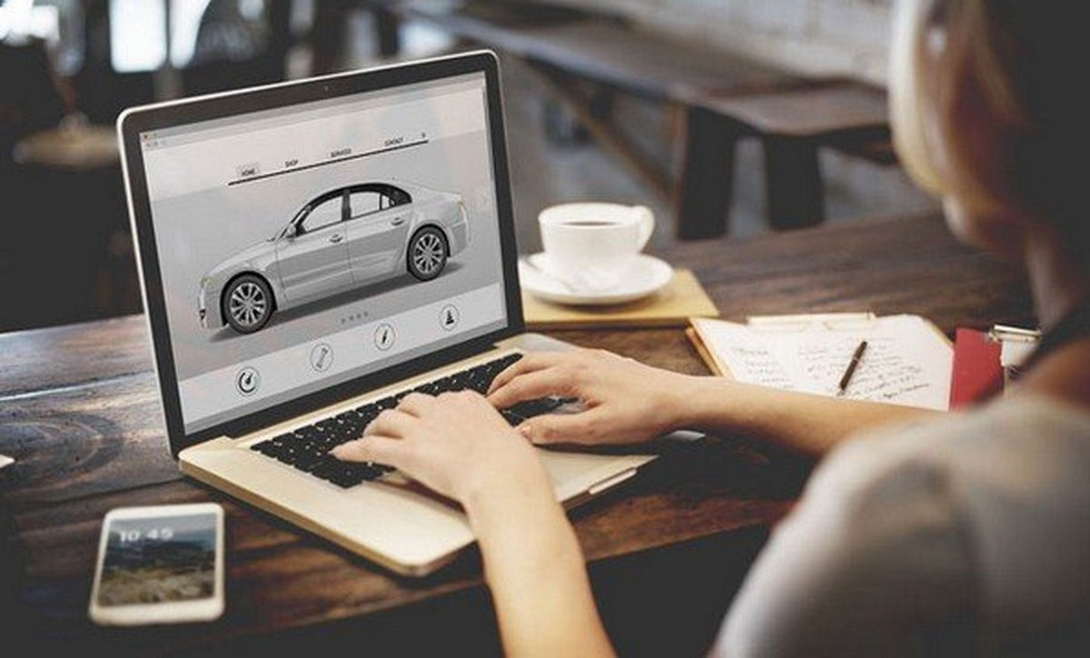 a girl searching about car on the laptop