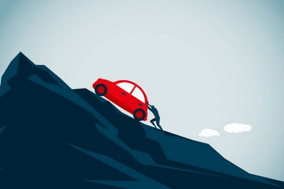 illustration of a man pushing the car to the top of the mountain