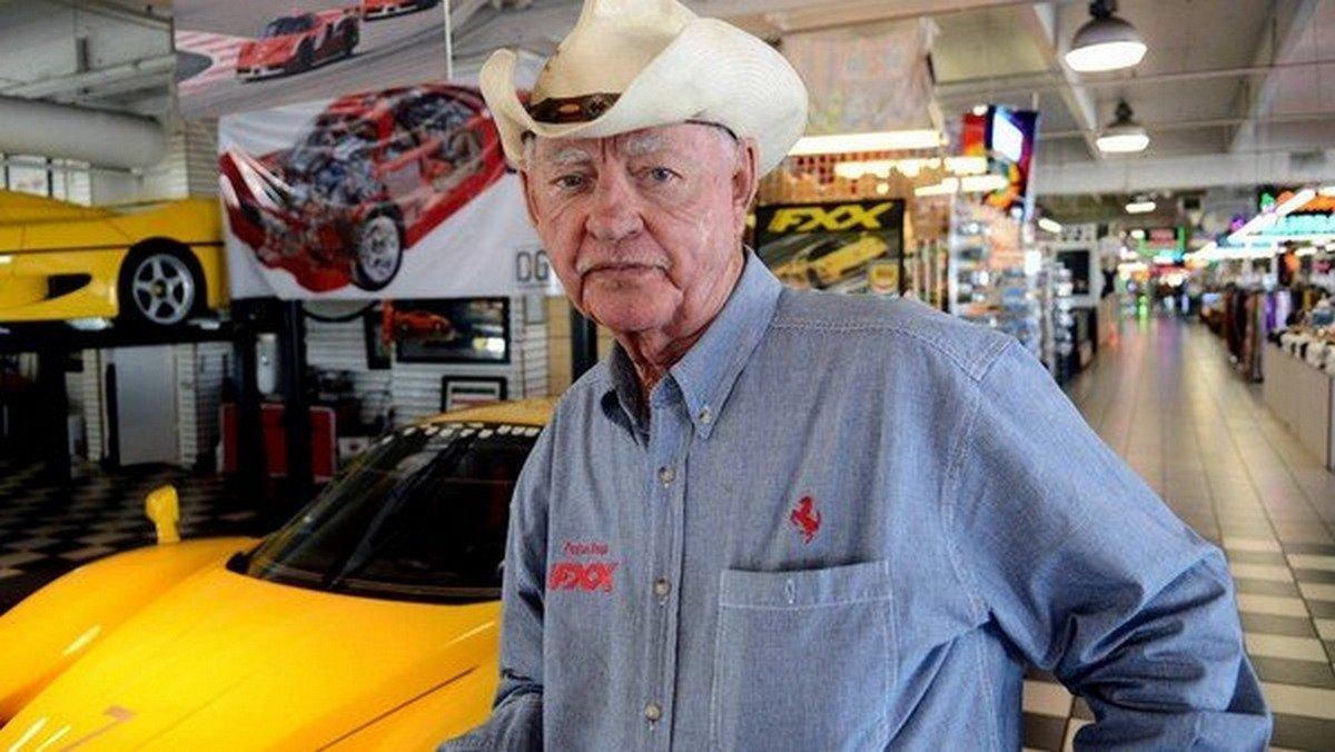 Preston Henn in a flea market, wearing a cowboy hat