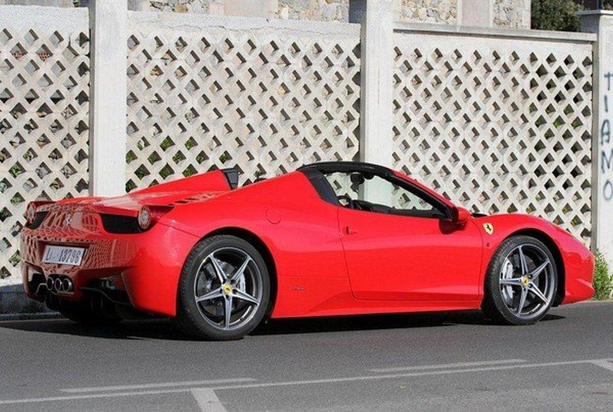 Red Ferrari 458 Spider rear-side view
