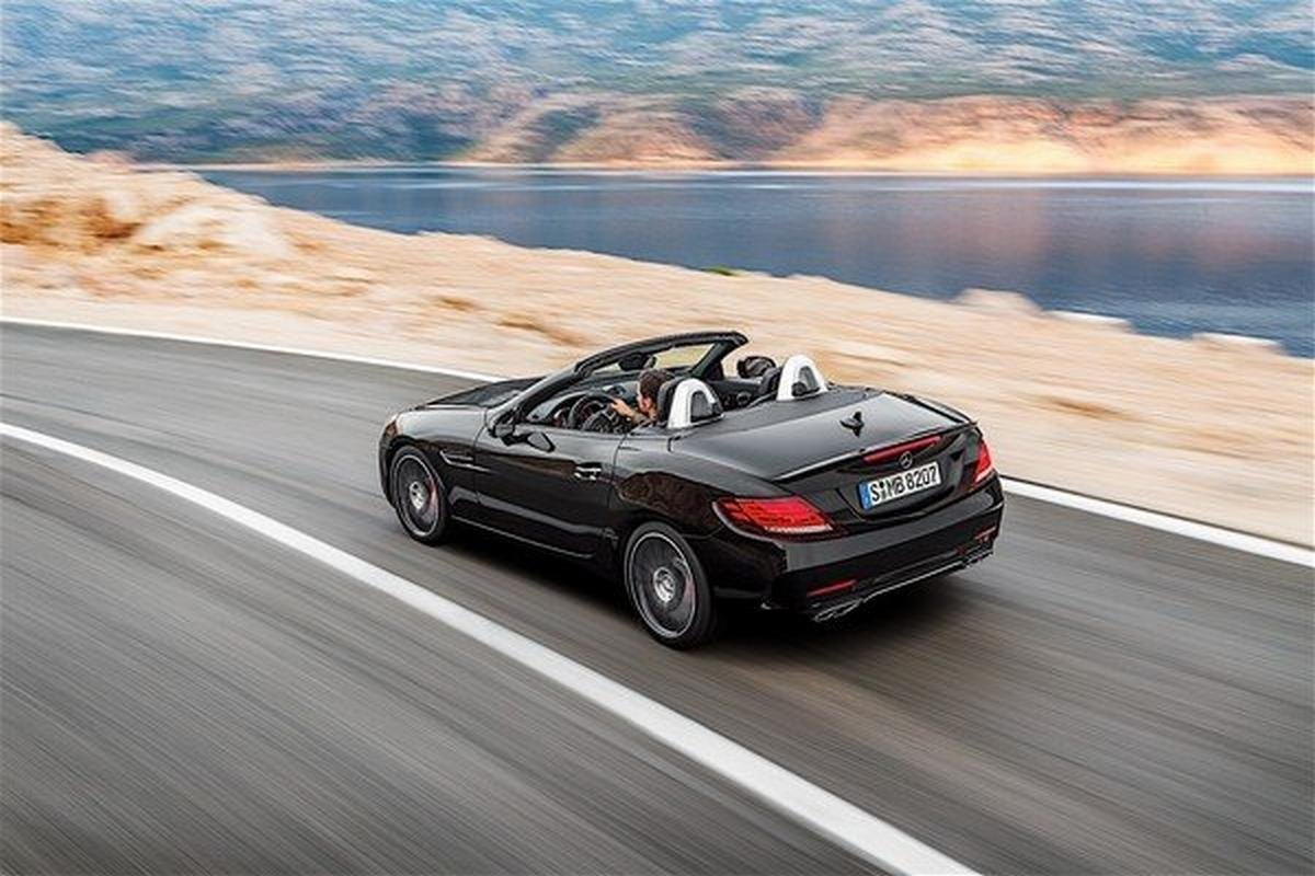 A black Mercedes-Benz cruising along the lakeside