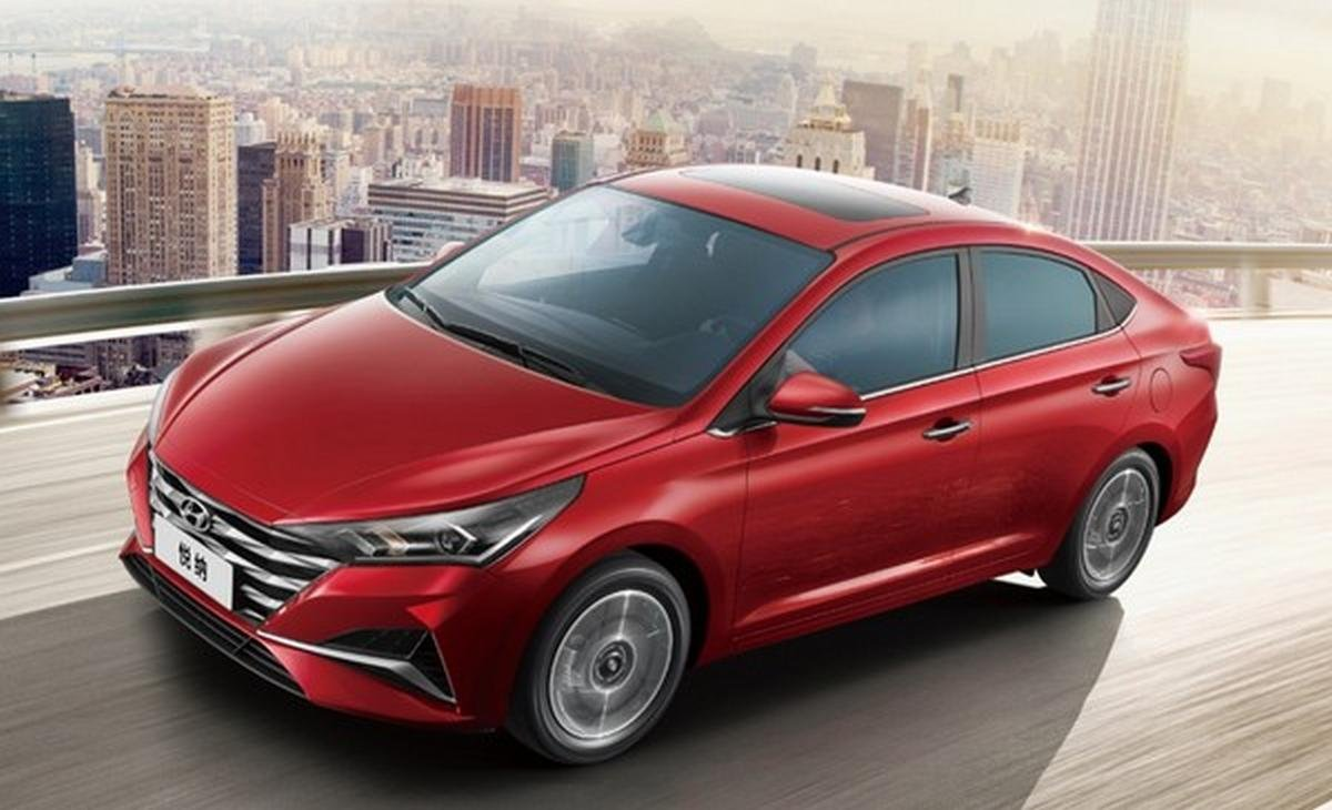 new hyundai verna facelift red colour front three quarters left side