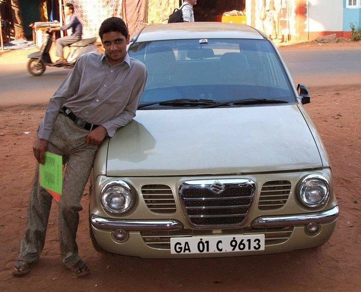 An Indian man proudly leans on his brand new Zen Classic