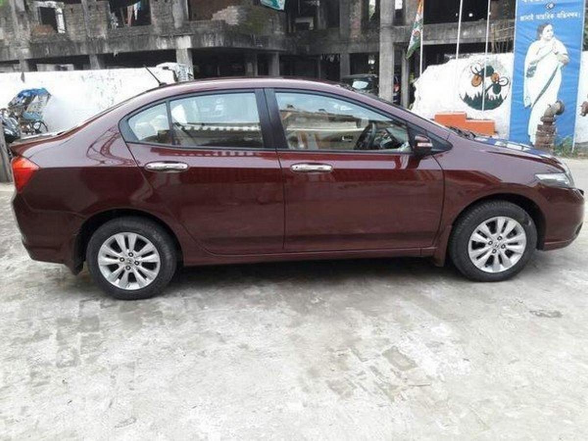 2012 used Honda City brown side profile