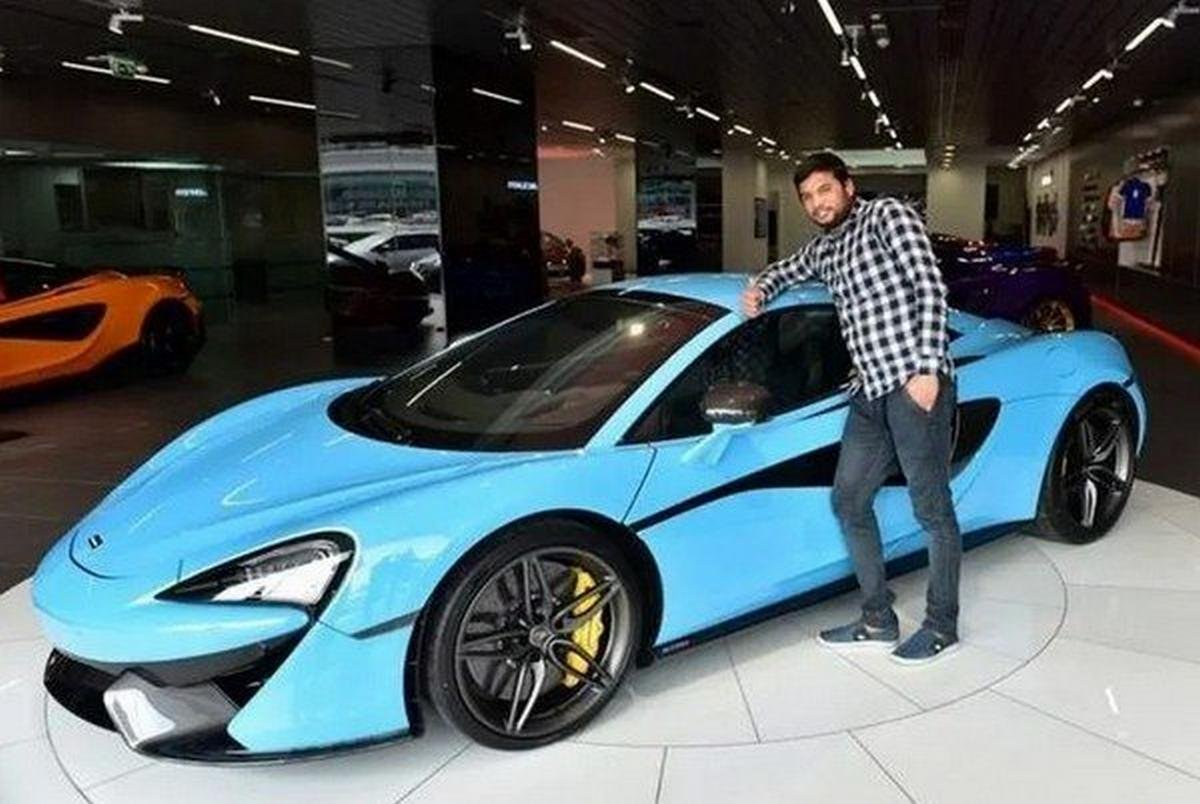 McLaren 570S Spider blue side profile angle with Balvir Singh