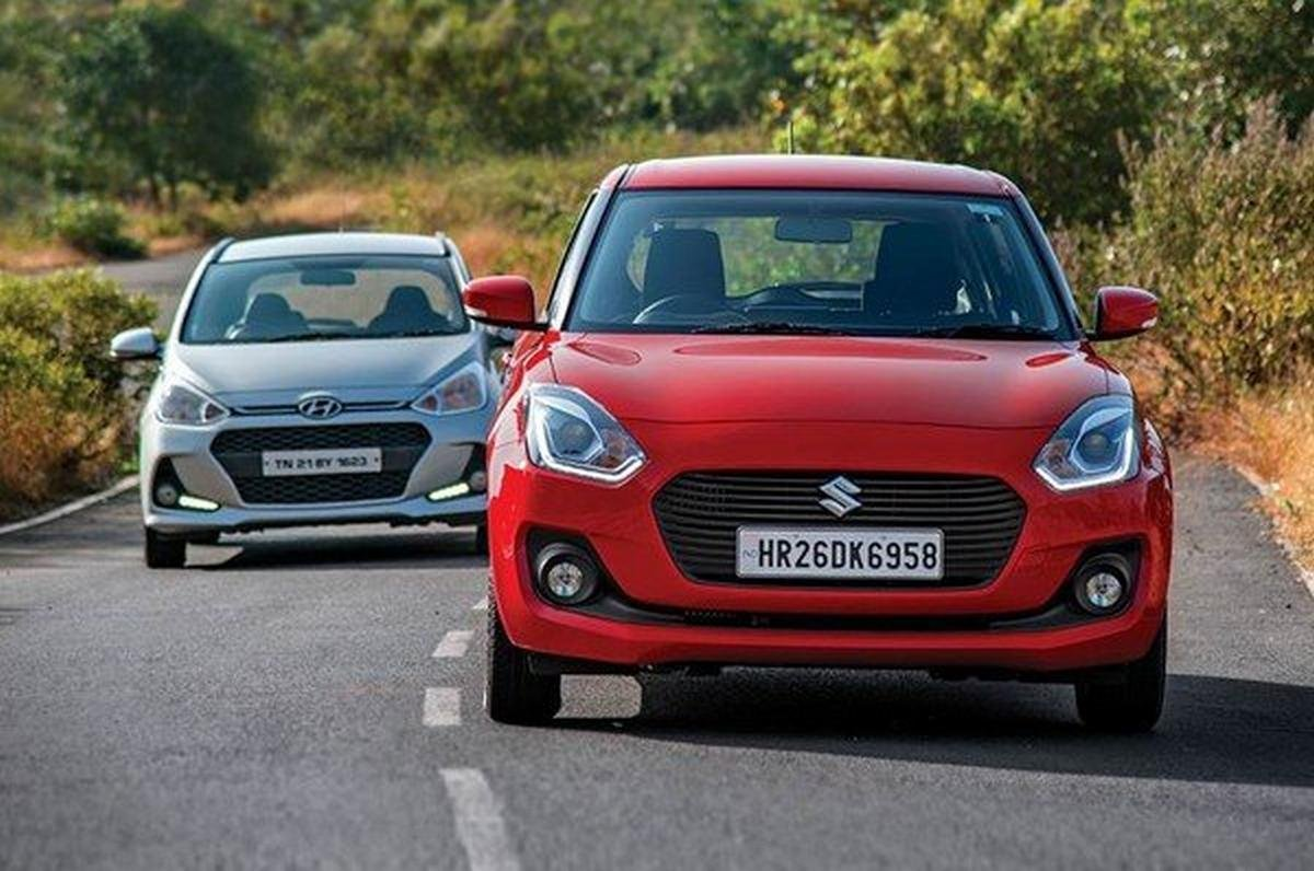Maruti Swift red vs Hyundai Grand i10 front