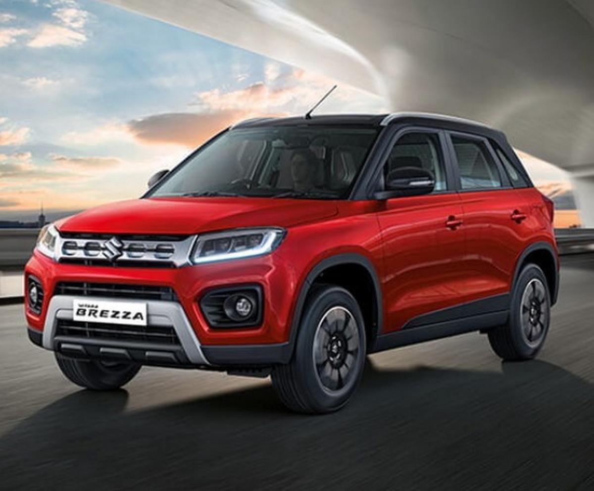 upcoming maruti cars in india in 2021 - maruti vitara brezza red colour front three quarters