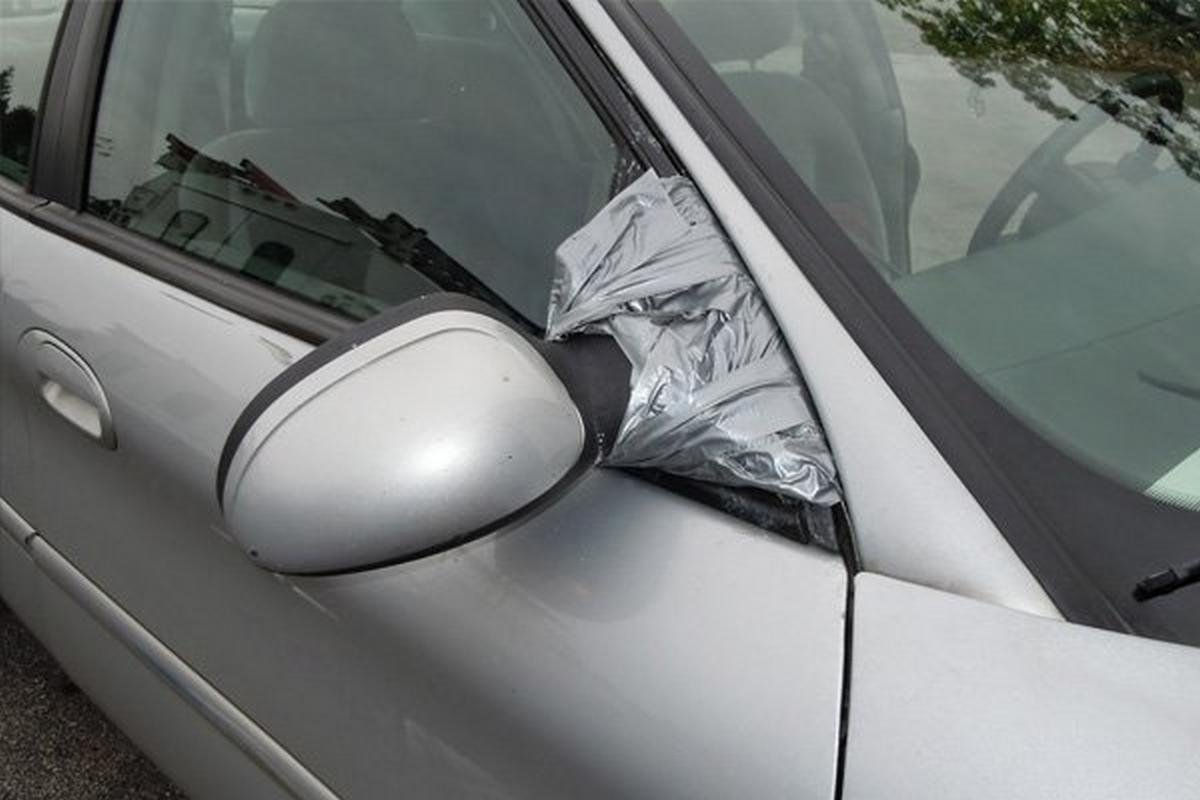 duct tape covers a car mirror