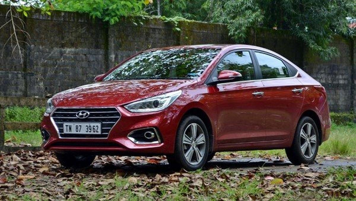 Hyundai Verna on the grass red color