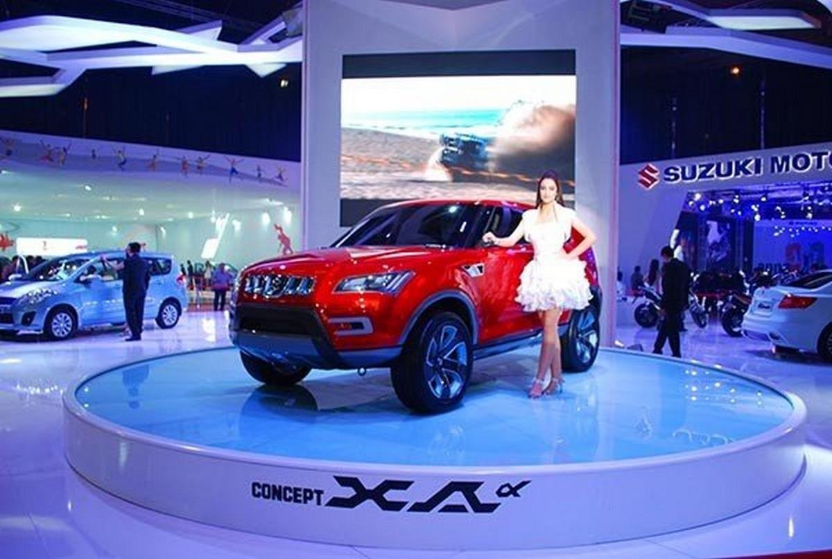 Maruti Suzuki car at auto expo show with a model standing by