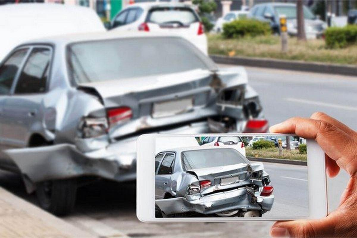 taking photo of a damaged car