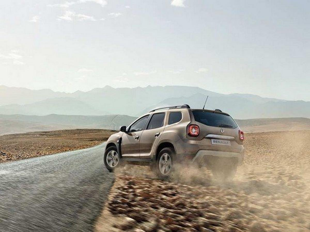 2019 Renault Duster travelling on road with sand