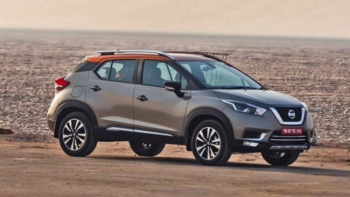 Silver Nissan Kicks on desert from left to right