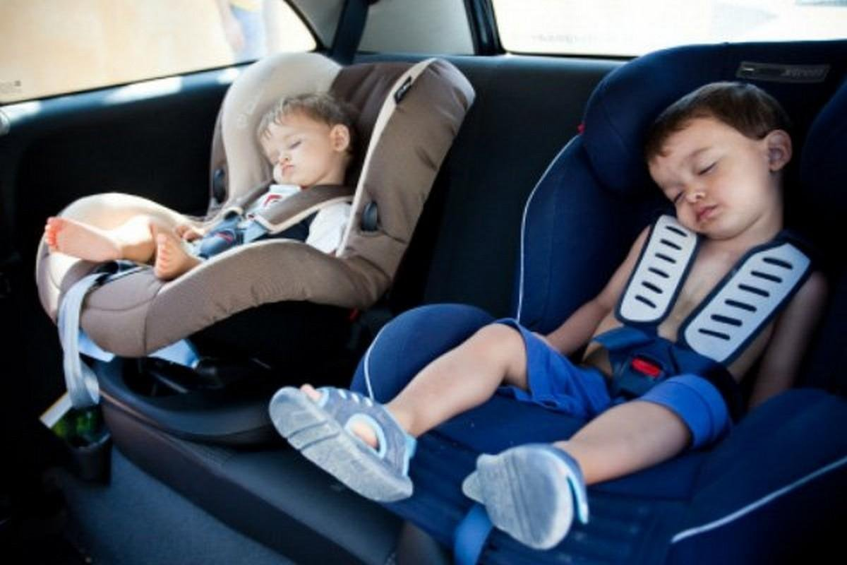 2 kids are sleeping at the back seats