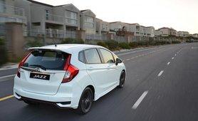 Honda Jazz 2018 run on road white colour rear look