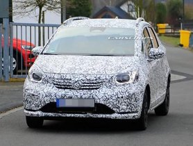 Next- Generation Honda Jazz Begins Testing In Disguise, Interior Partially Revealed