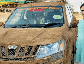 Senior doctor of Pune coated his Mahindra XUV500 with cow dung