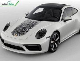 Porsche Latest Design Feature: Massive Fingerprint On The Car Hood