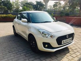 2018 Maruti Swift LXI Petrol MT for sale in New Delhi