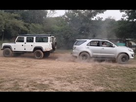 Check Out Toyota Fortuner Engaged in a Tug of War with an old Land Rover Defender