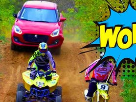 Check Out a Stock Suzuki Swift Racing With Dirt Bikes And ATV On A Dirt Track