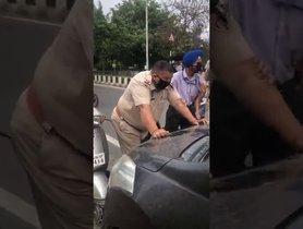 Youth Drags Policeman On Bonnet Of His Maruti Ertiga