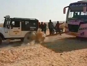 Watch Mahindra Thar Pull A Bus Out Of Sand!