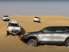 Old Toyota Fortuner and New Model Help Each Other Get Out of Soft Sand