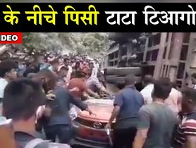 Tata Tiago TOTALLY CRUSHED Under a Truck, Driver Survives [VIDEO]